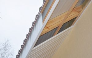 Close up on Soffit and Fascia Installation. Roofing Construction.